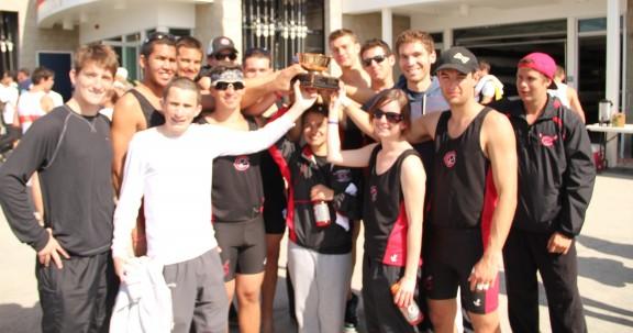 Chapman University Men's Crew team celebrates its first place win at the Newport Regatta.
