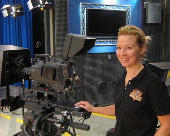 NASA cinematographer Jillian Arnold (MFA '07) reminds students there's work beyond Hollywood. Arnold is pictured here in the at Dodge College of Film and Media Arts studio, where she teaches electronic cinematography.