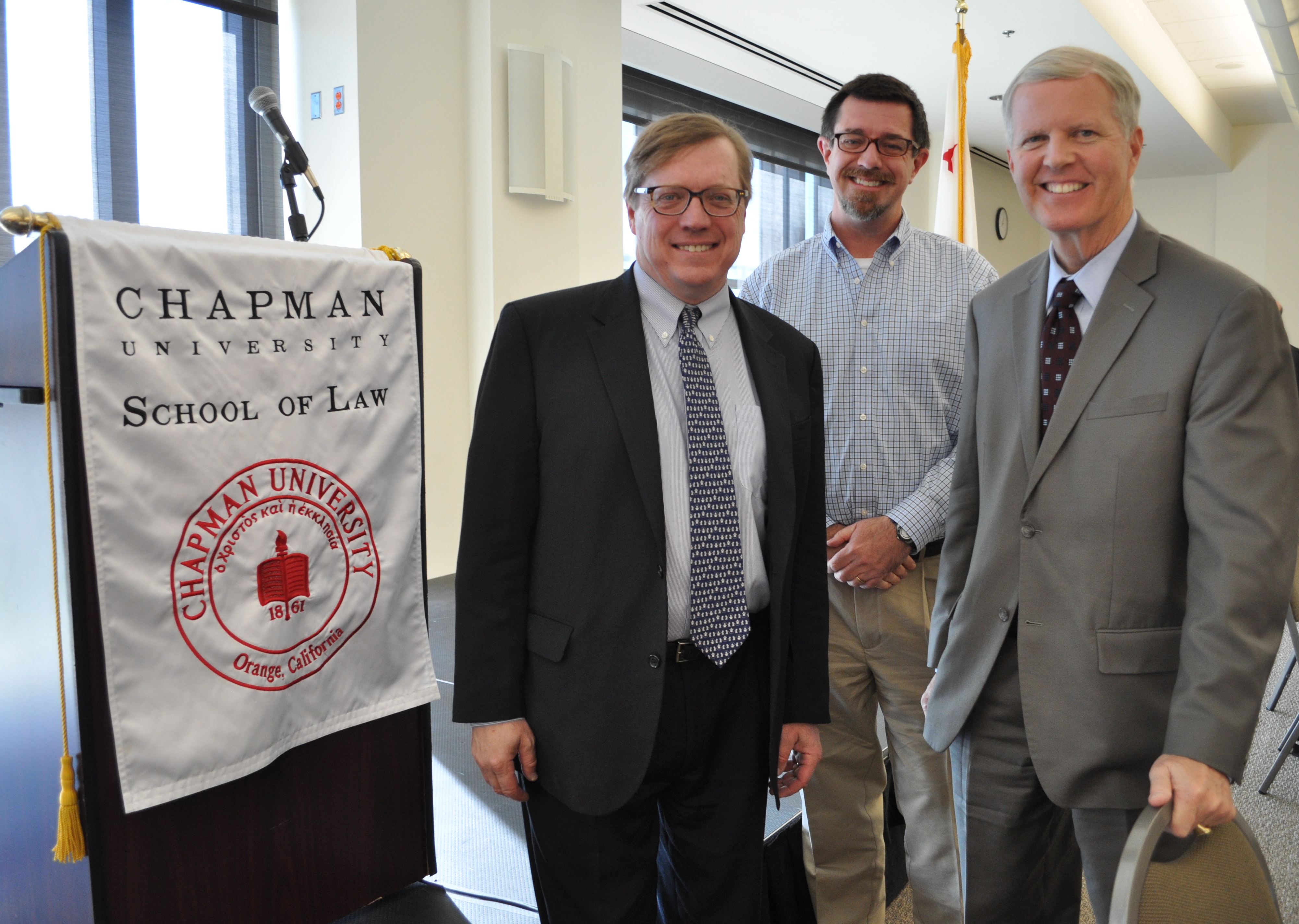 Ambassador David Scheffer, far left, is joined by John Hall, professor of law, and Tom Campbell, dean of the Chapman School of Law, during a visit to campus this week.