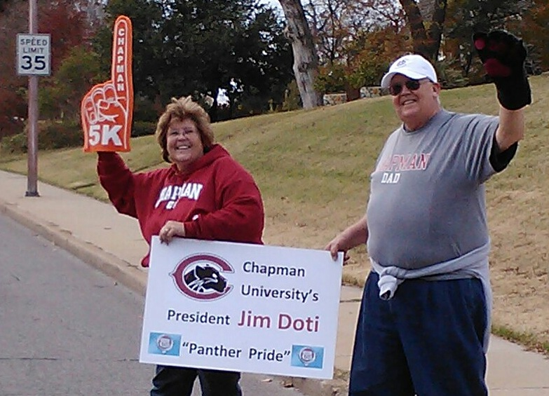 Chapman parents and Oklahoma residents Susan and Mike Bass surprised President Doti with a boost of Panther Pride during the Williams Route 66 Marathon.