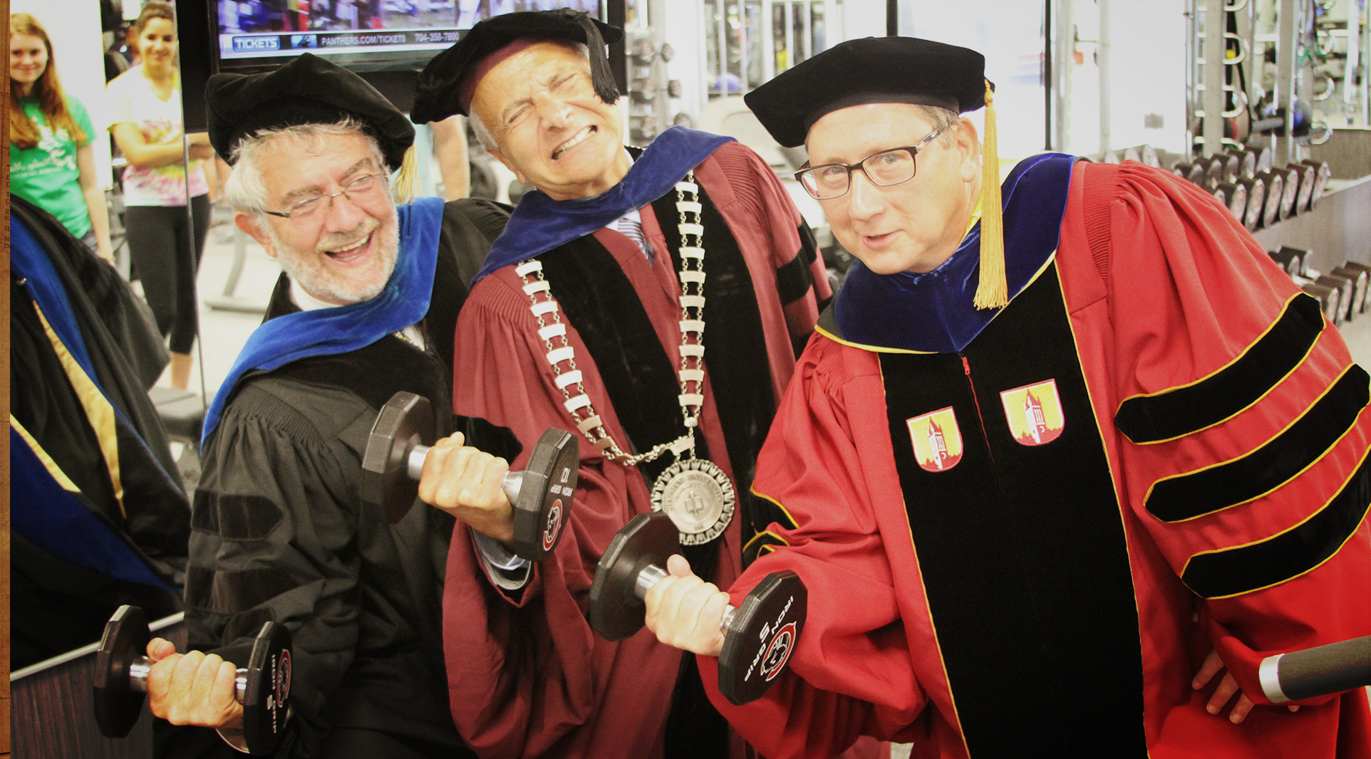 Chancellor Danielle Struppa, Presidnet Jim Doti and Associate Vice Chancellor Jerry Price check out the new equipment in the Julianne Argyros Fitness Center immediately following Convocation 2013. Don't fret -- the new dress code does not require caps and gowns.