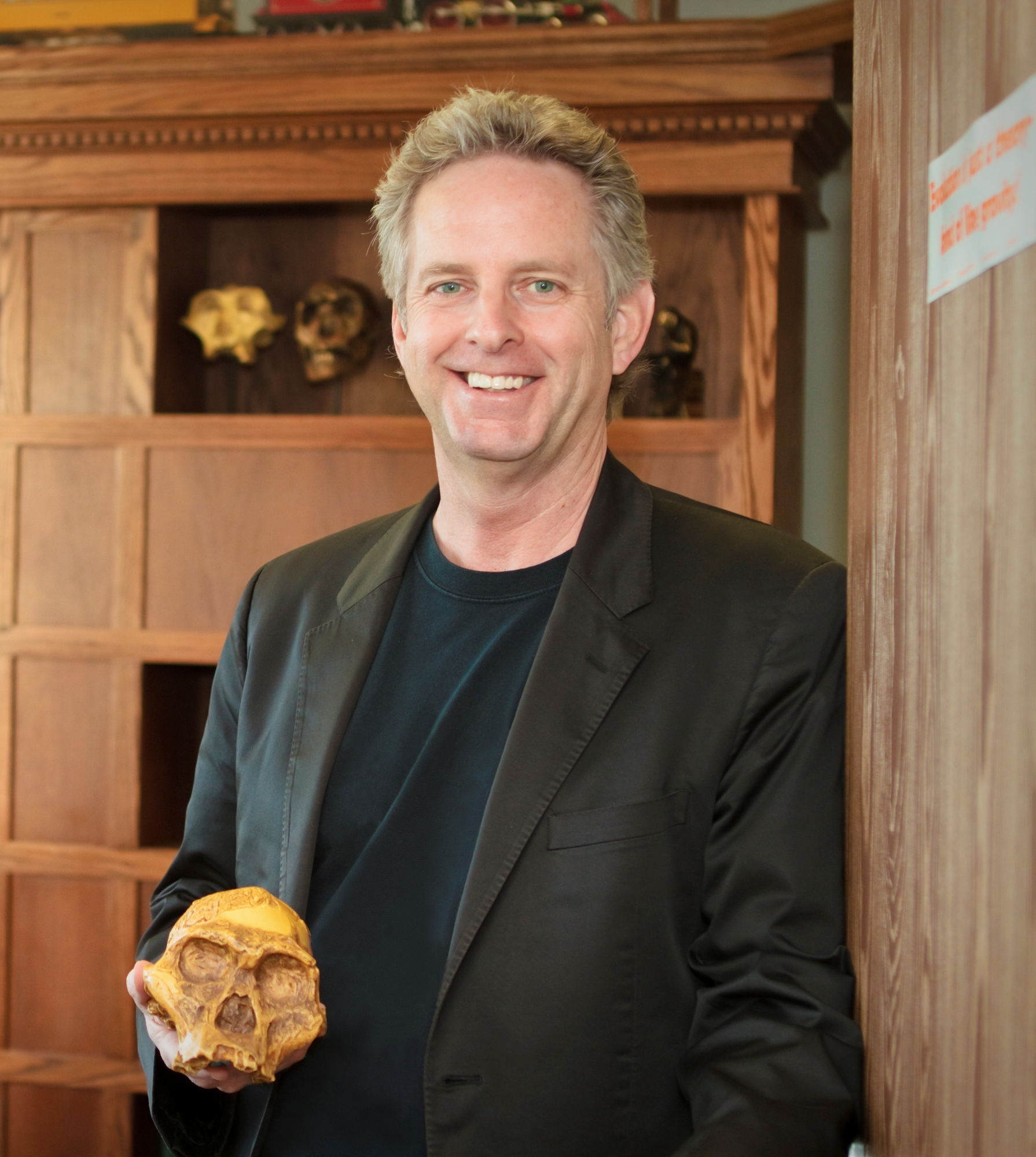 man smiling with skull