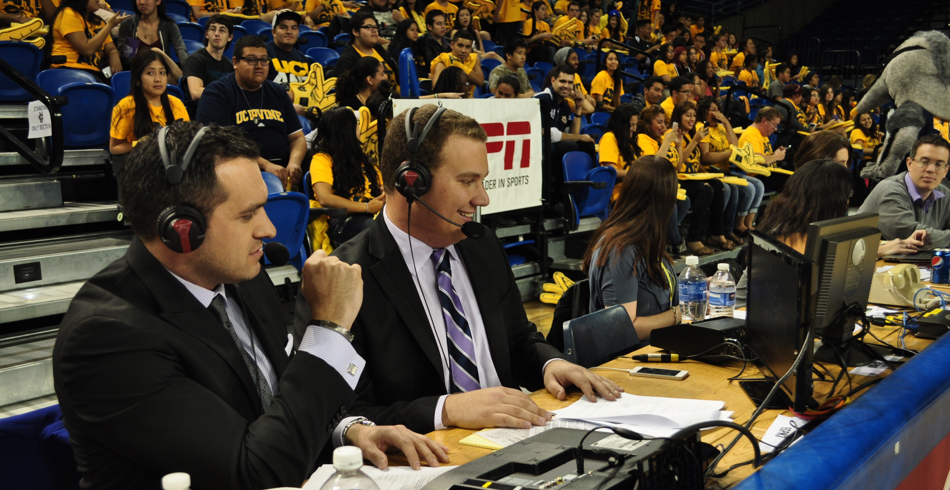 announcers at sporting event