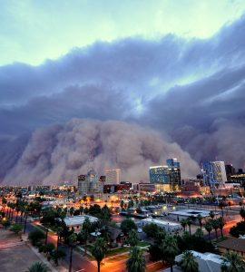 big smoke clouds over city