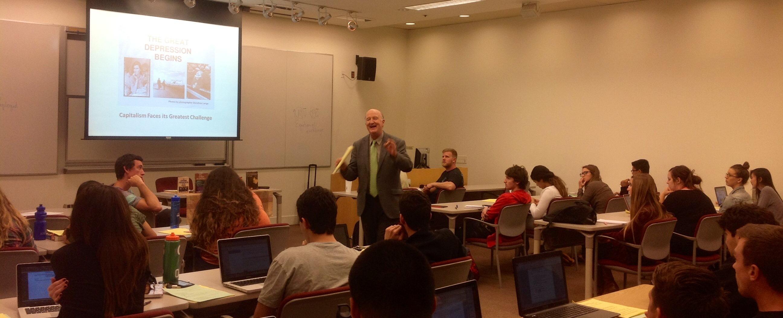 man speaking to classroom