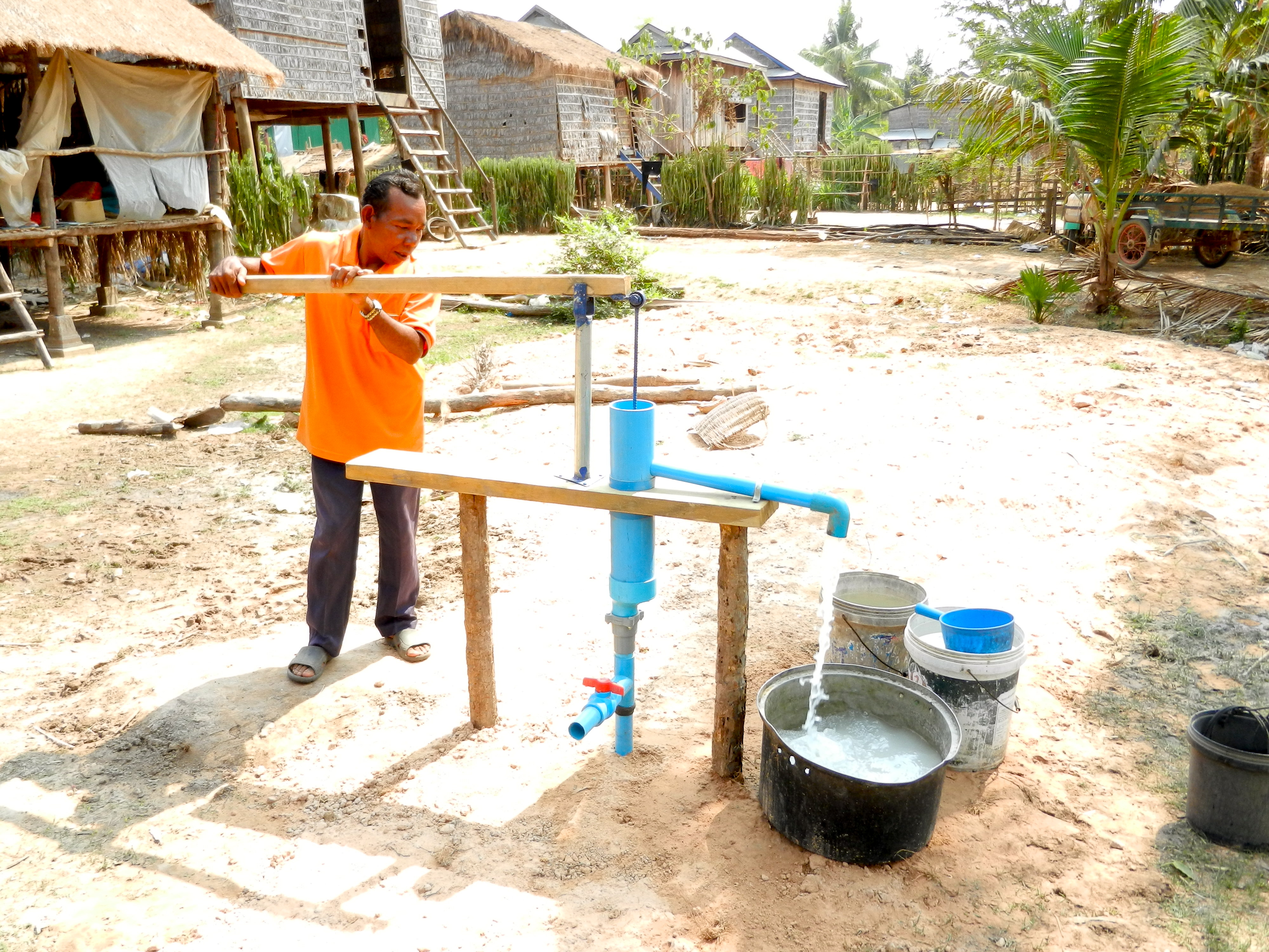 man using water well