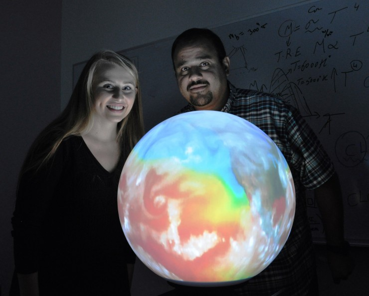 students with rainbow ball