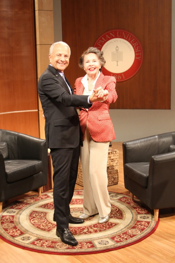 "President Jim Doti and film star Leslie Caron share a light moment after taping an episode of ""Dialogue with Doti."""