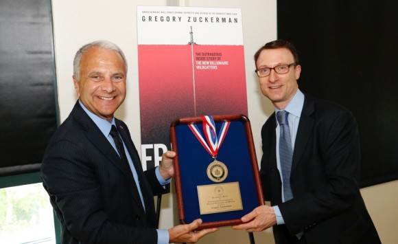 President Jim Doti included Zuckerman's book on his summer list of recommended reading to students this year and invited the author to speak to campus. Following the talk, Doti presented Zuckerman with The Presidential Medal for Distinguished Contributions to Business Journalism and Writing.