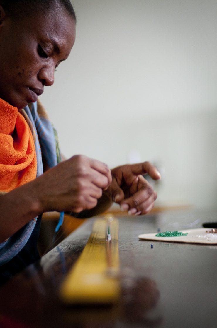 artist creating Sasa Designs jewelry.