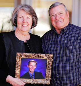 two people holding a picture