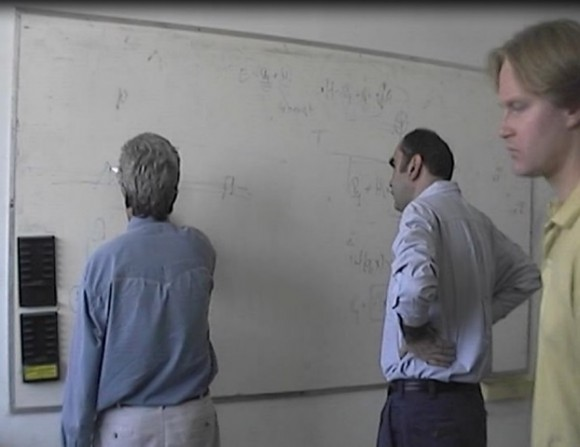 Quantum physicists (from left) Yakir Aharonov, Sandu Popescu and Jeff Tollaksen work on the Cheshire Cat theory during the 1990s.