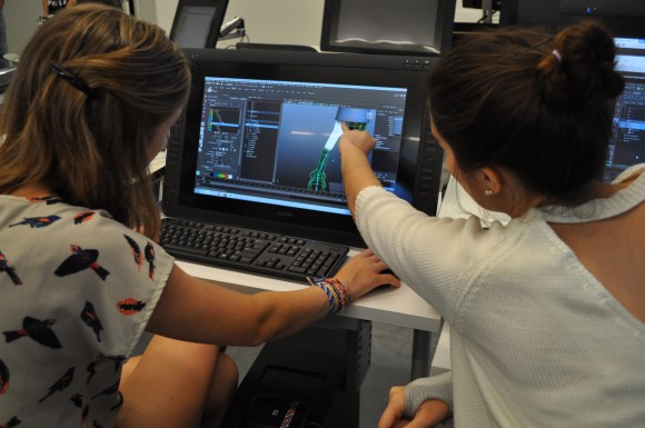 Jennifer Re '15 offers a suggestion to Taylor Reynolds '17 as she works on an animation project.