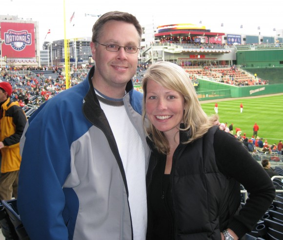 man and woman at baseball game