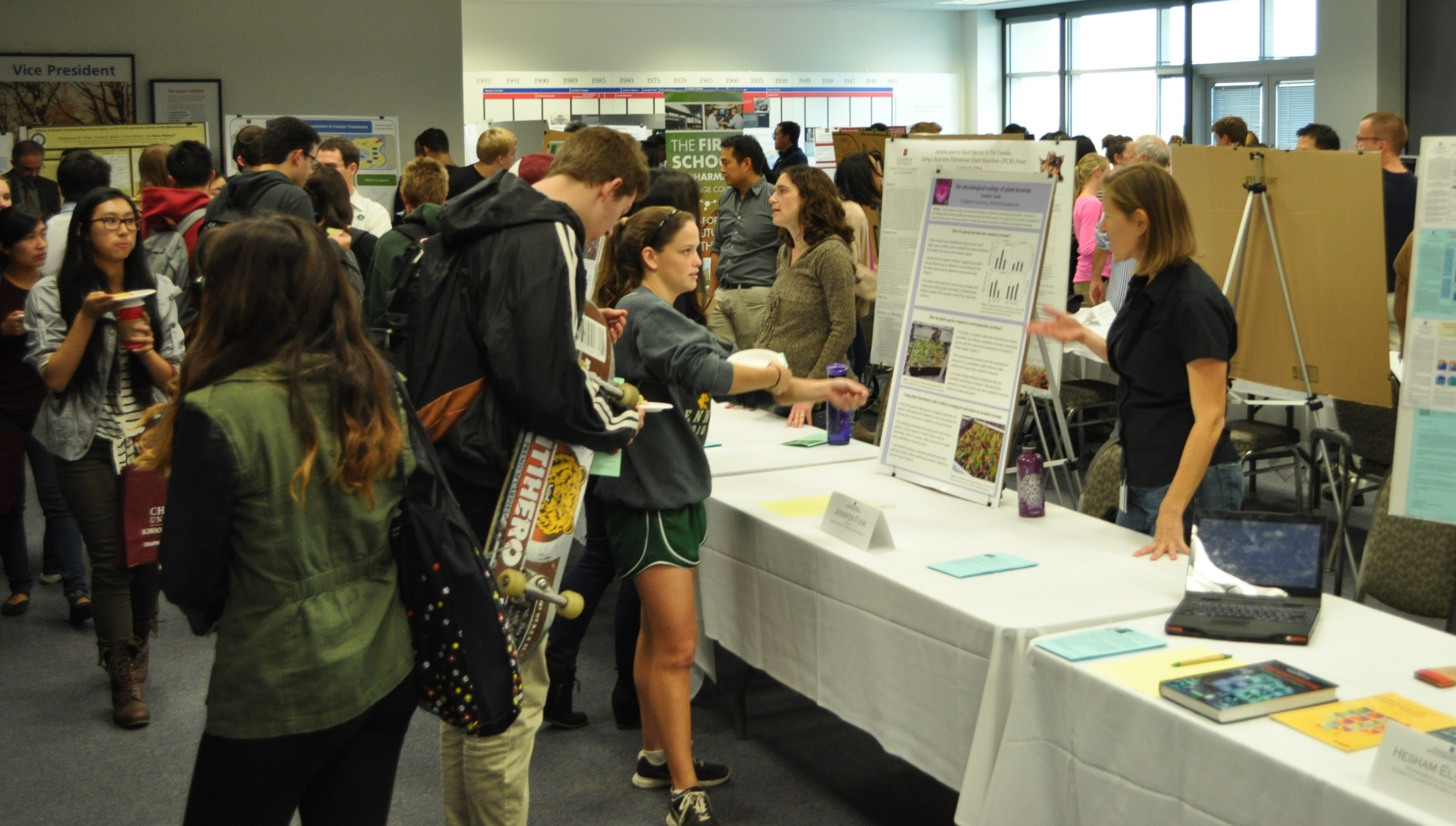 faculty and staff at research fair