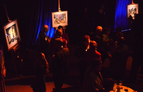 group in dark room looking at art