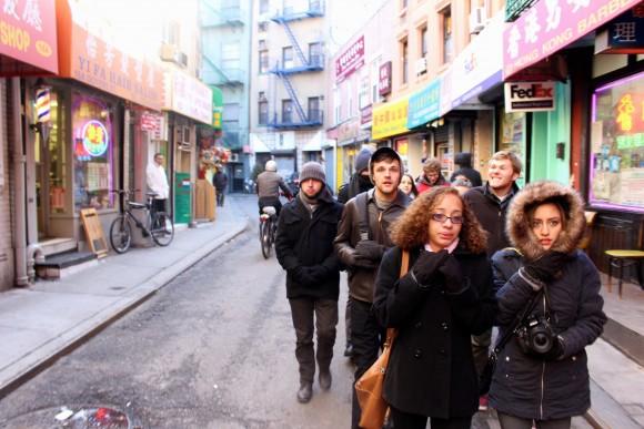 group walking down street