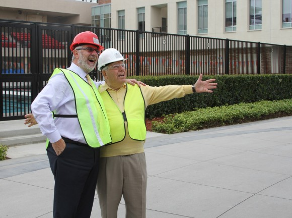Chapman Chancellor Daniele Struppa and namesake donor Paul Musco can't conceal their enthusiasm as they gaze at the rising Musco Center for the Arts.