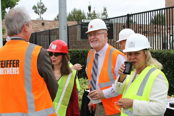 """""""My God, we have a venue!"""" exclaimed Bill Hall (center), dean of the Musco Center for the Arts, as he welcomed guests on the hard-hat tour."""