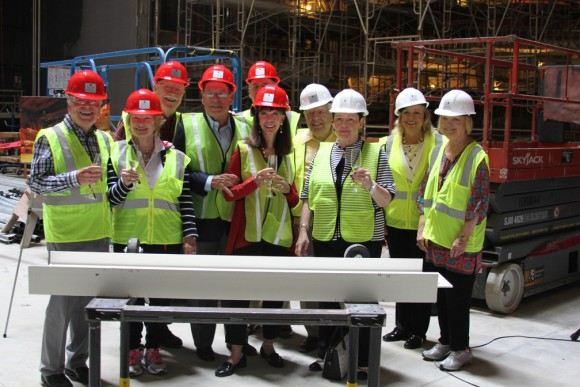 Gathered around the beam they just signed are Musco Center supporters Wylie and Bette Aitken, George and Julianne Argyros, Doy Henley, Sharon and Tom Malloy,and Kathy Hamilton (representing Women of Chapman).