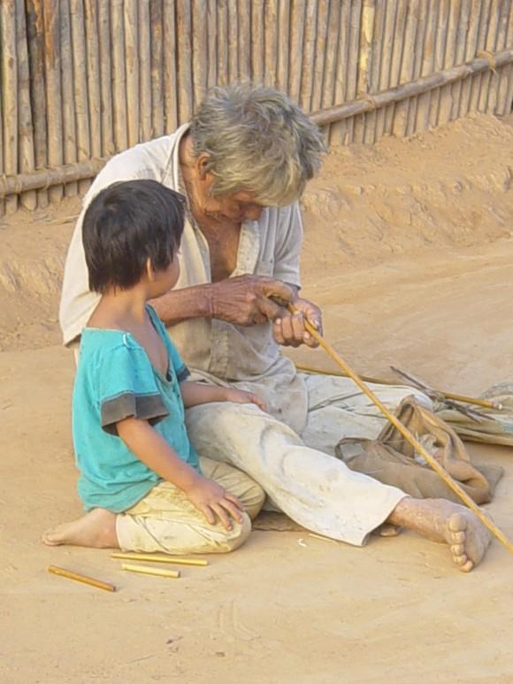 tsimane elder helping child