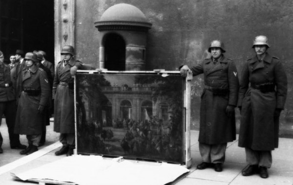 German soldiers pose with a looted painting during World War II.