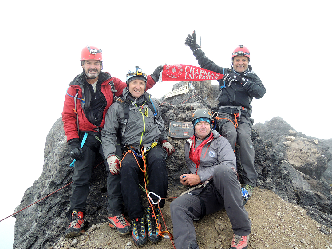 The expedition group and the Chapman pennant on top of the Carstensz Pyramid.
