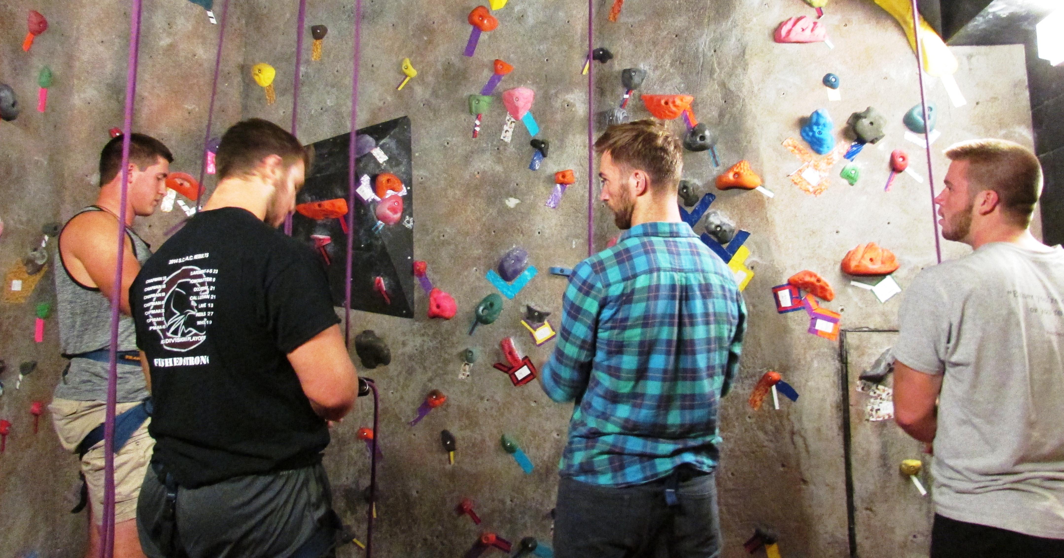 group at rock wall
