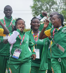 group of athletes wearing green