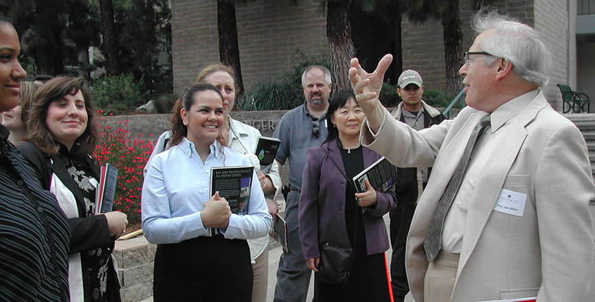 Professor Emeritus Jim Miller leads a campus tour in 2004