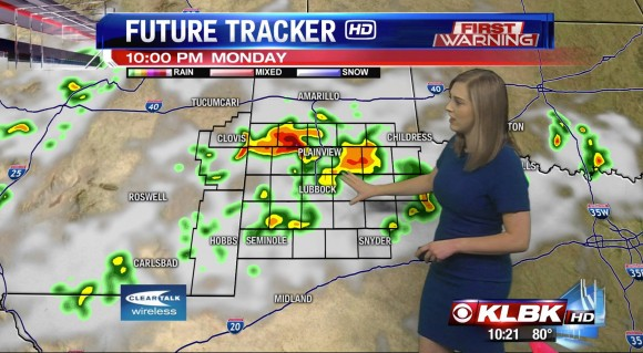 woman in front of weather forecast