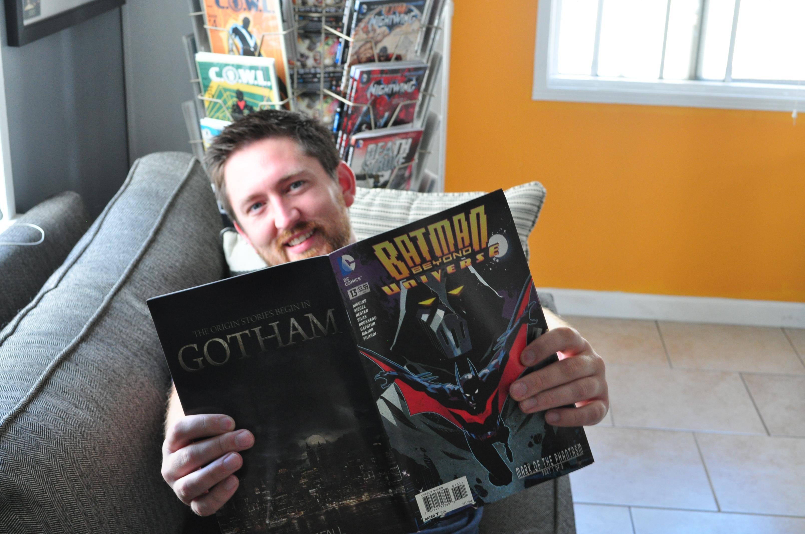 man reading comic