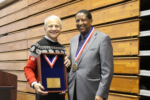 Michael Belay, right, accepts the Presidential Medal from Chapman University President Jim Doti.