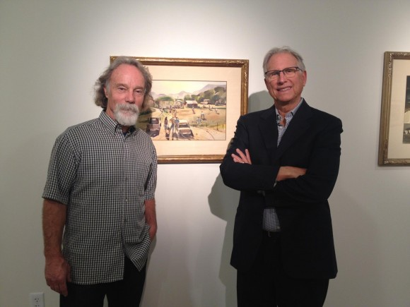 Curator Gordon McClelland (left) and donor Mark Hilbert pose with a painting by Millard Sheets inside Chapman University's new Hilbert Museum of California Art