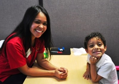 student and child smiling