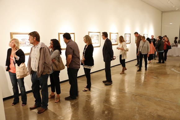 "Crowds appreciating the paintings in the Hilbert Museum's opening exhibition, ""Narrative Visions."""