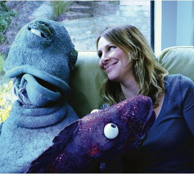 woman smiling at puppet