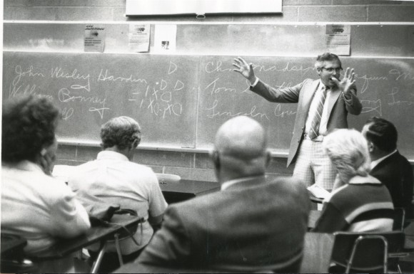 man teaching class
