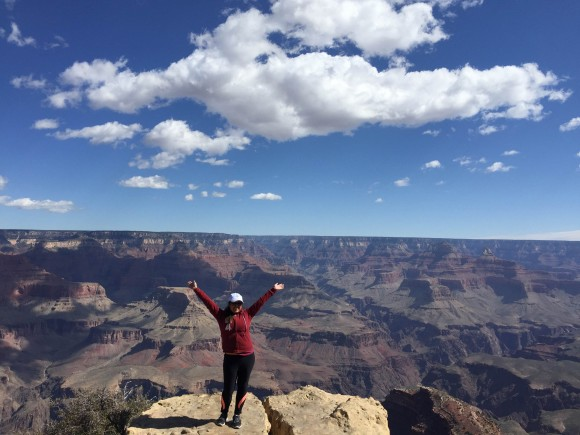 student smiling at the grand canyon