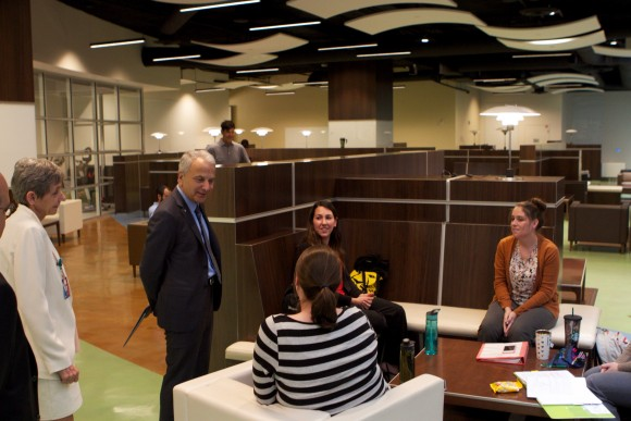 President Doti visits with students gathered in the Rinker Campus lounge.