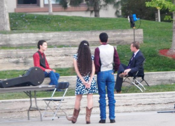students watch an interview