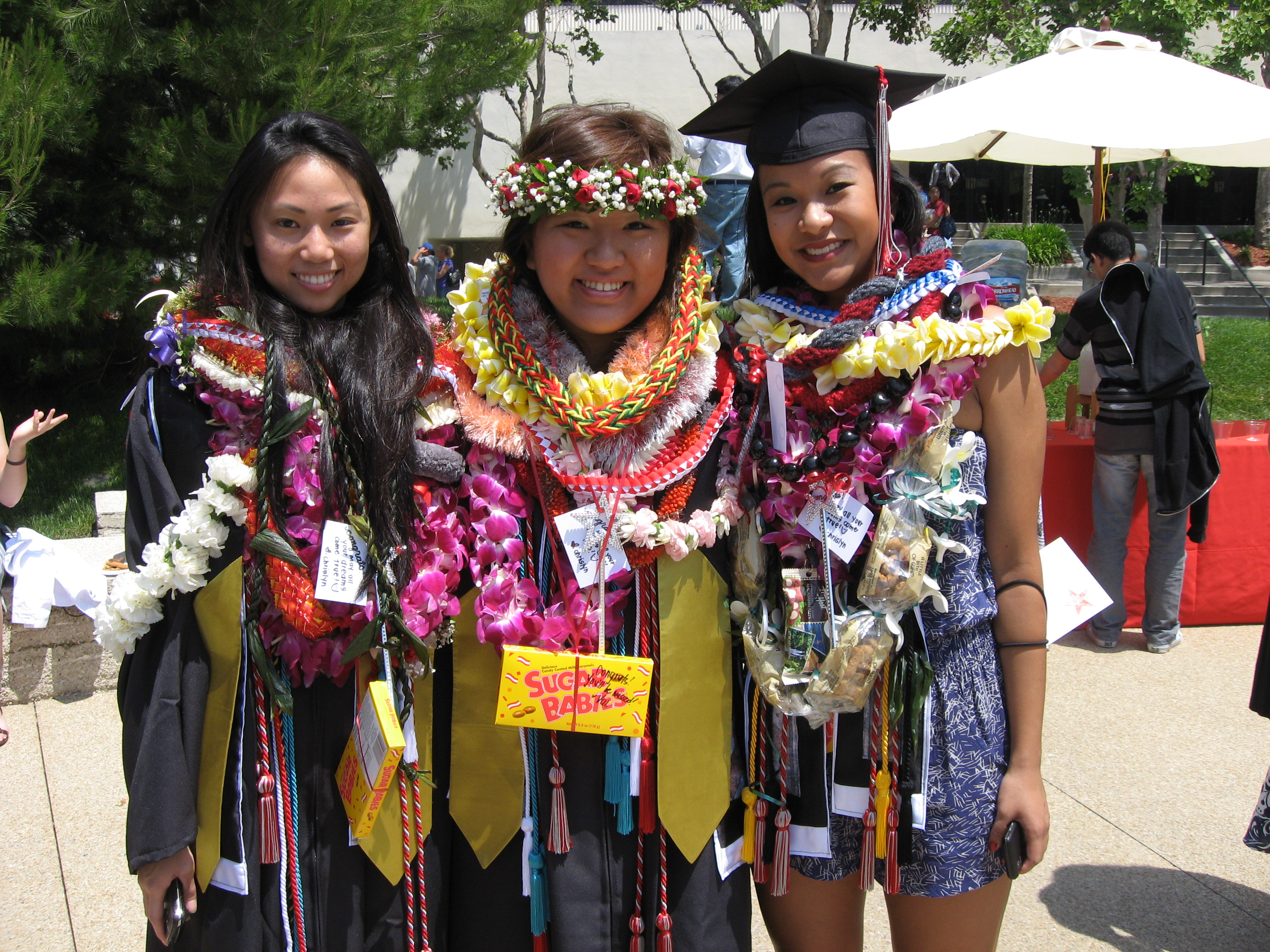 graduates in celebration leis