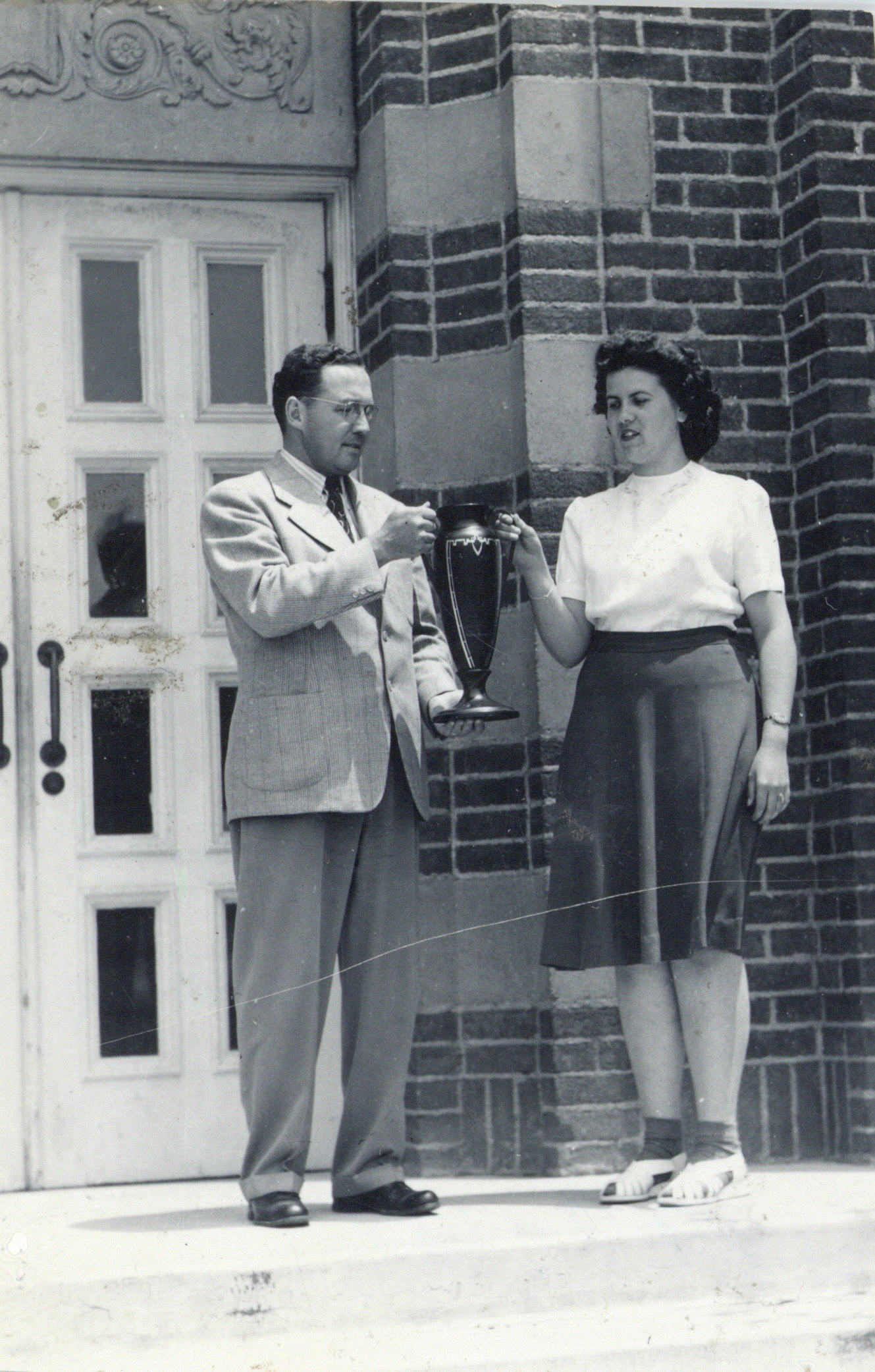 man and woman holding award