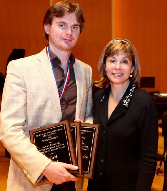 Winning guitarist Anton Baronov of Russia poses with JoAnn Falletta, the competition's namesake.