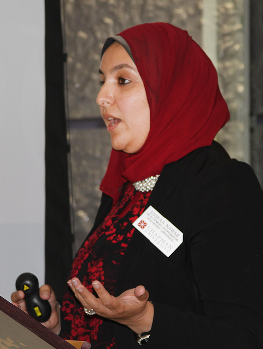 Essraa Nawar of Leatherby Libraries speaks at the MBO luncheon in Fish Interfaith Center.