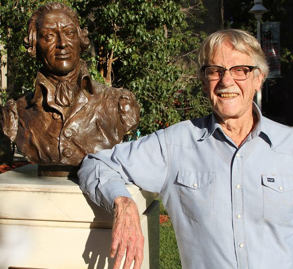 Nobel laureate Vernon L. Smith, Chapman professor of economics and law, poses with the bronze bust of moral philosopher Adam Smith on the Chapman campus. A $15M gift will establish the Smith Institute for Political Economy and Philosophy at Chapman, honoring both Smiths.