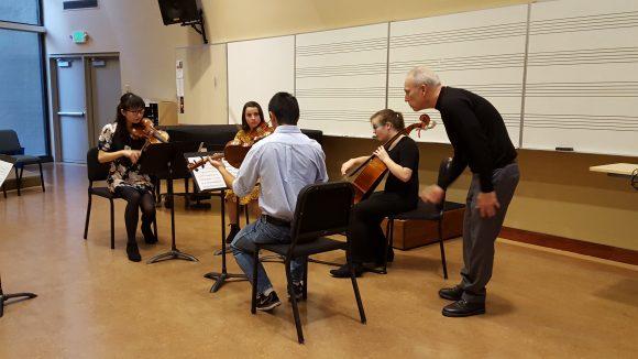Kronos Quartet member Hank Dutt works with Chapman string quartet during his master class.