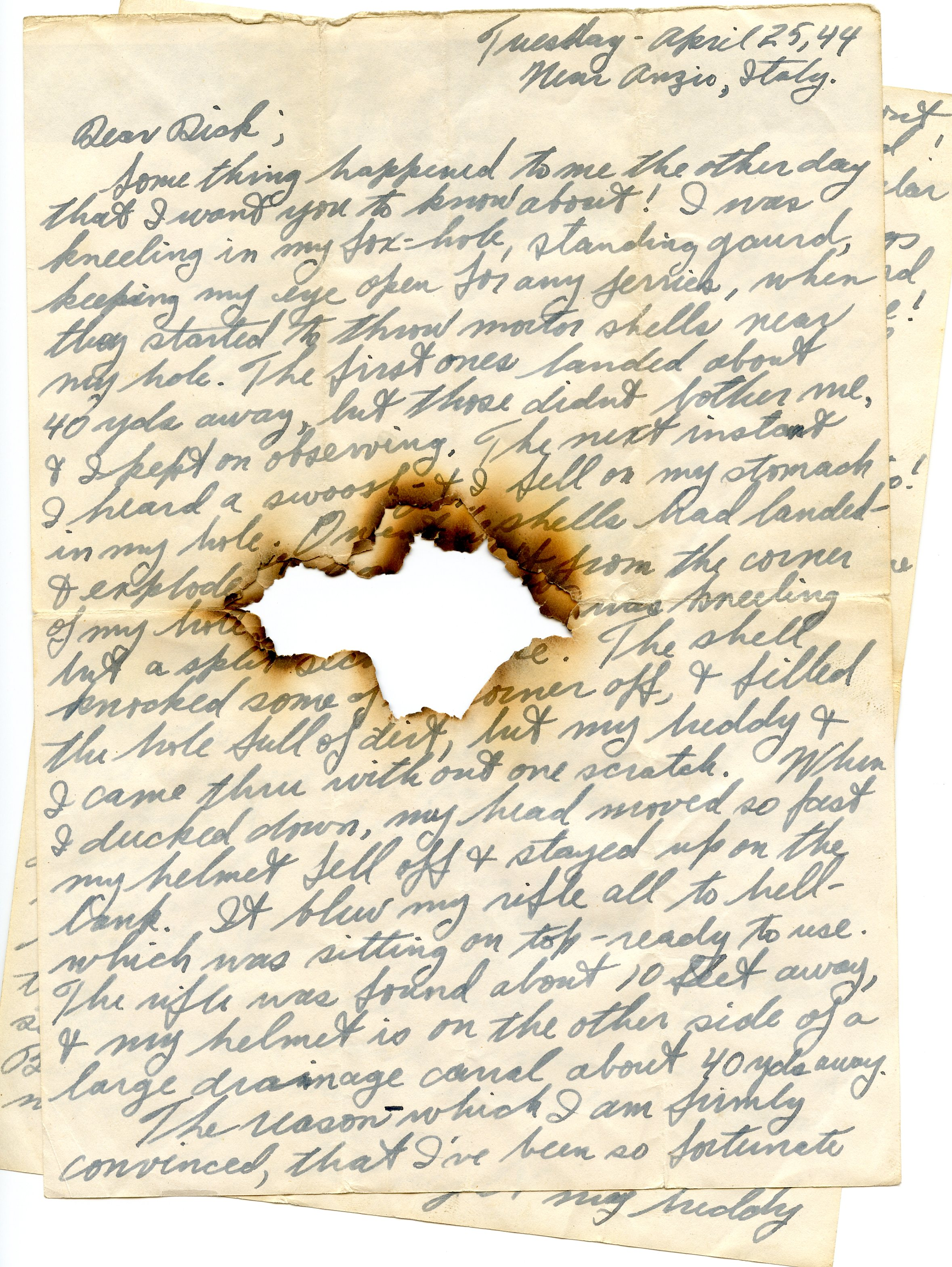 old letter with burn hole in the middle