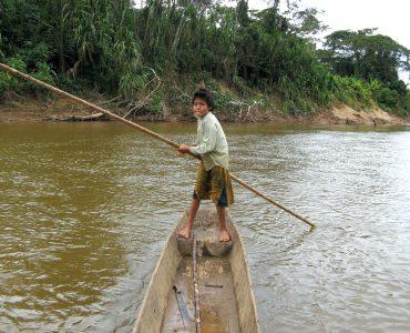 Boy on a canoe