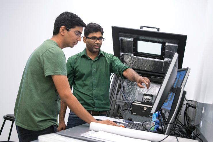 two students looking at computer